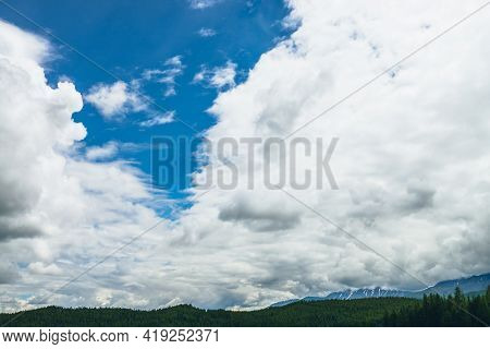 Scenic Nature Landscape With Beautiful Clouds In Blue Sky. Colorful Cloudscape With Clouds Above Sno