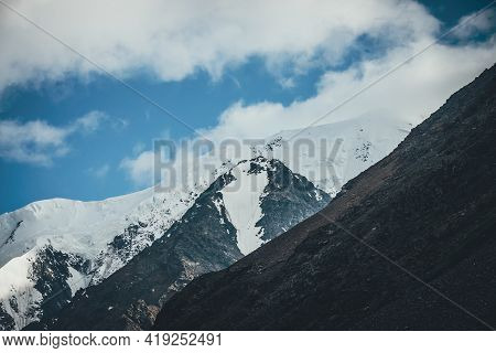 Awesome Mountain Landscape With Great Snowy Mountain Top. Atmospheric Scenery With Snow-white High M