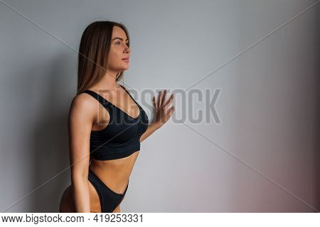 Extremely Beautiful And Young Adult Caucasian Woman Wearing Lingerie In A Boudoir Bedroom Setting In