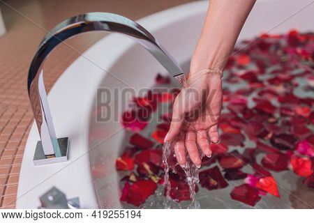 Portrait Of Beautyfull Hot Pinup Girl, Red Hair Taking Relaxing Bath With Flower Petals On White Cop