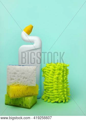 Cleaning Agent, Sponges And Cleaning Cloths On A Blue Background. The Concept Of Cleanliness