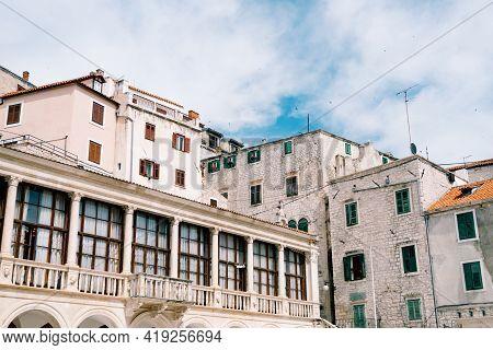 Houses Around The Basilica Of St. James In Sibenik, Croatia, Against A Blue Sky