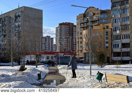 Balashikha, Russia - March 19, 2021. Residential Area On The Spring Sunny Day. Elderly Woman Careful