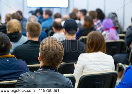 Audience listens to the lecturer at conference hall