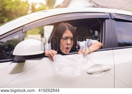 Asian Woman Puke Or Vomiting Into Plastic Bag In Car,car Sick And Motion Sickness