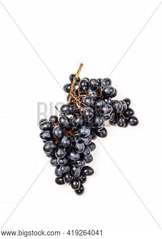Fresh Dark Blue Purple Grape Isolated On White Background. Wine Grapes, Table Grapes. Exotic Fruit