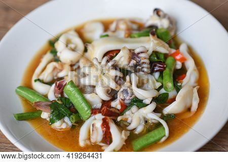 Fried Squid With Basil On White Plate, Stir Fried Spicy Basil Leave With Squid Cuttlefish Seafood Co