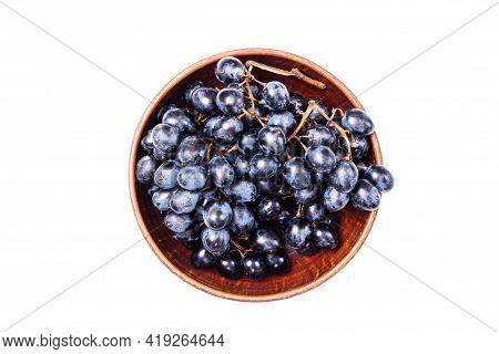 Fresh Dark Blue Purple Grape In Bowl Isolated On White Background. Wine Grapes, Table Grapes. Exotic