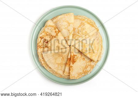 Pancake On The Green Plate. Many Pancakes Are Stacked. Thin Pancakes With Crispy Crust. Maslenitsa.