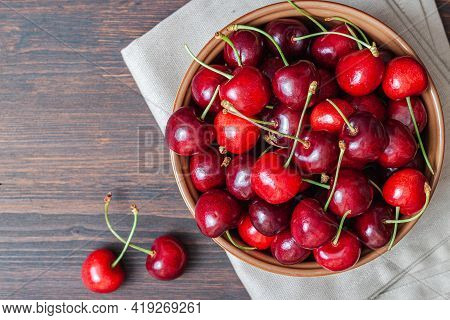 Cherry On Plate Bowl On Wooden Background. Ripe Ripe Cherries. Sweet Red Cherries. Top View Rustic S