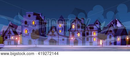 Medieval German Night Street With Half-timbered Houses In Fog. Traditional European Old Town Buildin