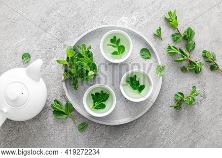 Herbal Mint Tea In Small Traditional Chinese Cups And Fresh Leaves, Healthy Antioxidant Drink