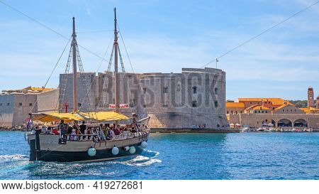 Dubrovnik, Croatia - Jine 12, 2017: Tourist ship going in the Old Port of Dubrovnik