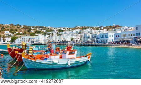 Mykonos Island, Greece - April 22, 2018:  Waterfront and fishing boats in the Old Port of Mykonos. Panoramic view