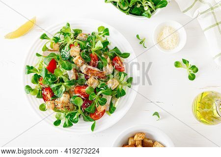 Caesar Salad With Grilled Chicken Meat, Fresh Tomato, Croutons, Lambs Lettuce And Parmesan Cheese. H