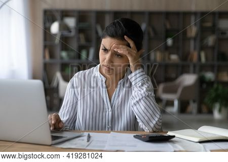 Frustrated Indian Woman Calculating Bills, Looking At Laptop Screen