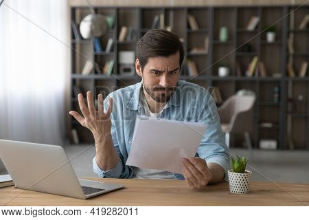 Unhappy Man Reading Bad Unexpected News In Letter, Having Problem