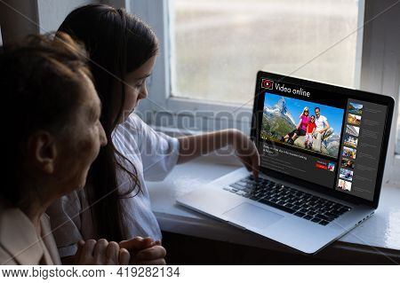 Little Girl Watching Travel Videos Online. Child Watching A Video About The Trip With His Family
