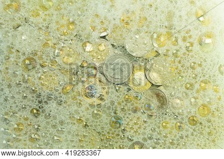 Money Laundering Concept, Dollars In Soapy Water. Laundering Of Banknotes And Coins, Conceptual Idea