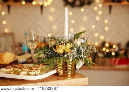 Burning Candle And Glasses Of Wine On Wooden Table. Table Set For An Event Party. Decorated Table At