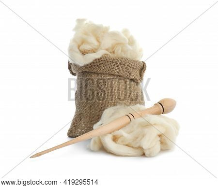 Soft Wool In Sack And Spindle On White Background