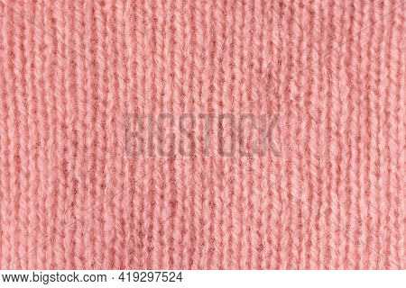 Texture Of Knitted Angora Fabric. Coral Wool Texture. Knitted Jersey Background With Relief Pattern