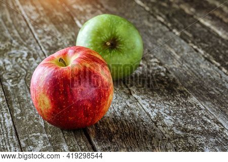 Green And Red Apples On Blackboard Or Chalkboard Background. Bright Fruit Composition.red And Green