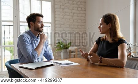 Professional Male Employer Holding Job Interview With Female Job Seeker.