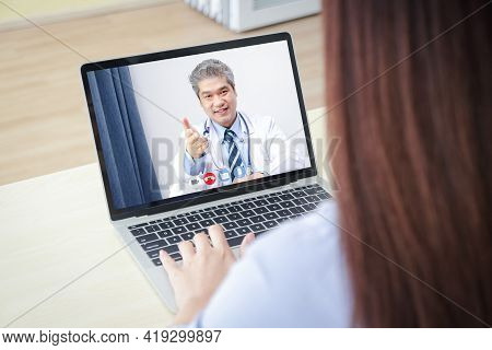 Online Doctor Concept Monitor Patient Health Through A Laptop Connected To Communication Via Online