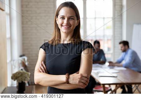 Portrait Of Confident Smiling Attractive Female Team Leader.