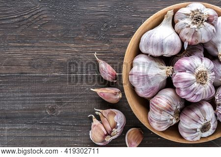Garlic Cloves On A Wooden Vintage Background.
