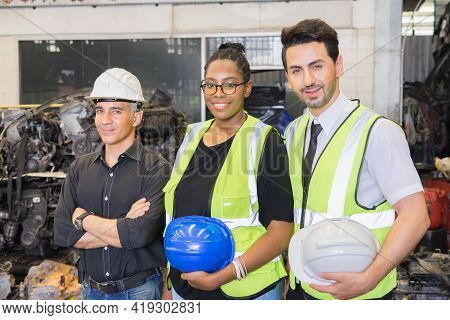 Men And Woman Work Together, Holding Helmets And Looking Straight. Caucasian Engineer Manager Men We