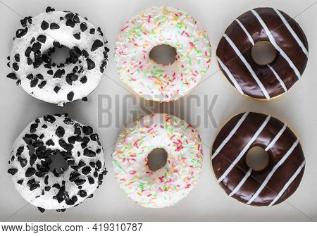 Flat Lay Image Of Six Ring Donuts With White Glaze And Colourful Hundreds And Thousands, Chocolate A
