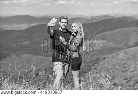 First Love. Couple In Love. Family Relationship. Man And Woman In Mountains. Romantic Selfie. Valent