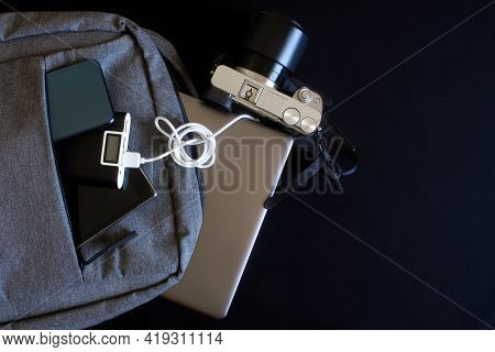 Modern Gadgets - Smartphone, Tablet, Mirrorless Camera, Laptop Or Ultrabook Lie In A Gray City Backp