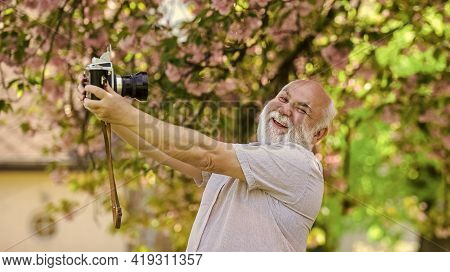Making Selfie. Senior Bearded Man Photographing. Professional Photographer Designer. Man Tourist Use