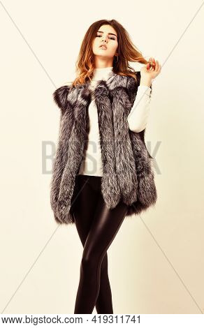 Winter Fashionable Wardrobe For Female. Boutiques Selling Fur. Woman Makeup Face Wear Fur Vest White