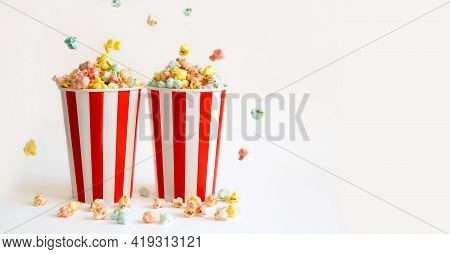 Two Large Filled Glasses With Colorful Sweet Popcorn For Fun Watching Movies In The Cinema. Banner.