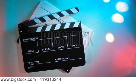 Black And White Clapperboard Or Movie Clapper Board Or Slate On Neon Pink Peach,blue,tiffany Blue ,m
