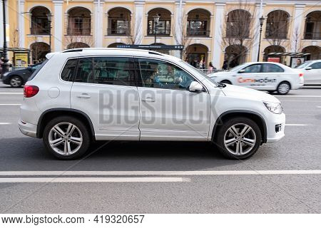 St.petersburg, Russia, 03.05.2021: White Volkswagen Car Crossover On The Street Road. White Volkswag