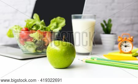Healthy Snack With Working In Office.  Close Up Green Apple For Diet Health Plan On White  Table Wor