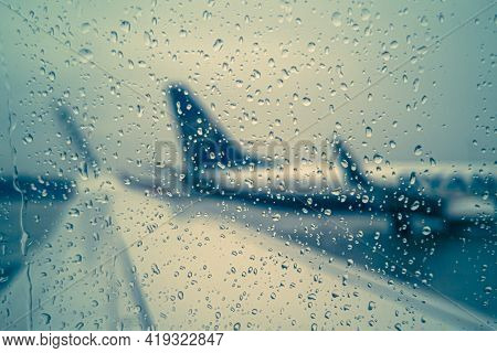 The Concept Of Flight Delay Or Cancellation, Raindrops On The Glass Against The Background Of A Wing