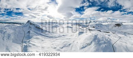 Spectacular Panoramic View Over Snowcapped Mountain Peaks.