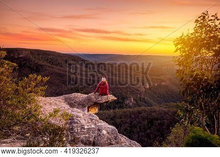 Woman Watching Sunset Over Mountains Landscape In Southern New South Wales, Australia