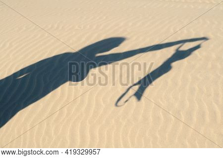 Close Up Of Young Woman Taking Off Her Bra At Nude Beach. Concept Of Sunbathing Naked On The Sandy O