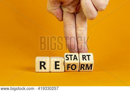 Restart And Reform Symbol. Businessman Turns Cubes And Changes The Word 'restart' To 'reform'. Beaut