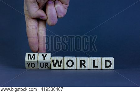 My Or Your World Symbol. Businessman Turns Wooden Cubes And Changes Words 'your World' To 'my World'