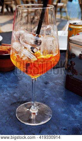 The Italian Aperitif, The Alcoholic Spritz King Of Happy Hour On An Outdoor Table