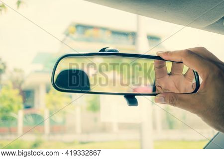 Adjusting The Rearview Mirror In The Car To Provide A Better Rear View For Safe Use Of The Car, Rear