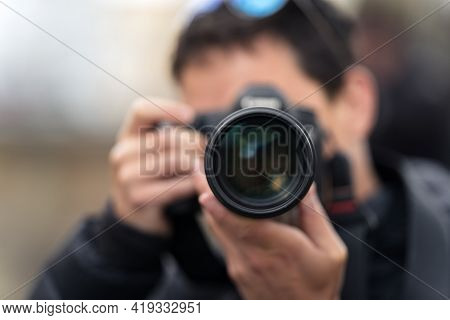 Photographer Reporter Taking A Photo, Close Up Of The Lens